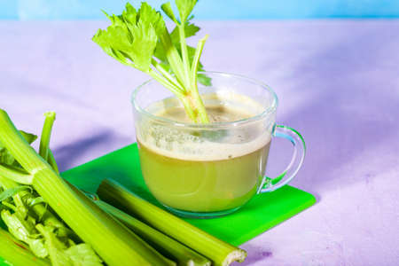 Healthy Celery diet for the treatment of incurable mysterious diseases. Fresh celery juice squeezed out on a juicer.drink, vegetable juice, studio shot
