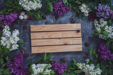 Background for greeting card greeting beloved woman wedding invitation flowers lilac on wooden surface
