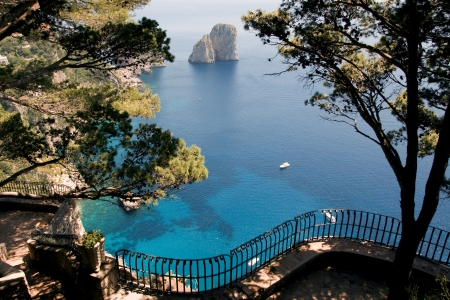 View from a cliff on the island of Capri, Italy, on rocks in the sea Фото со стока