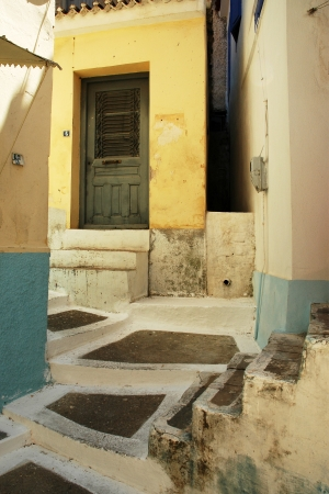Narrow alley in the old part town of Samos, on the same name island, Greece  photo
