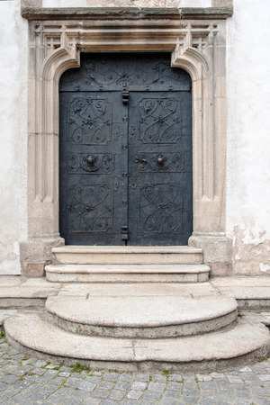 Old ancient entrance door made of iron to the castle chapel in Telc, Czech Republic