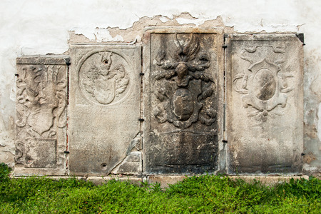 ancestors: Medieval tombstones from the 17th century on the wall of the chapel in Telc, Czech Republic