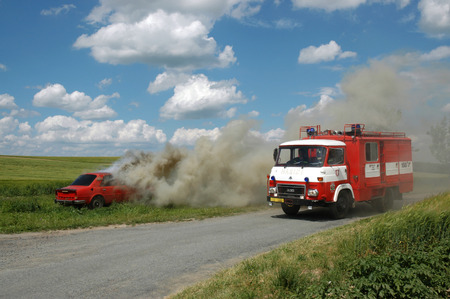 extinguishing: JESOV, CZECH REPUBLIC, JUNE 29, 2008 - Exercise firemen, demonstration of fire extinguishing of car