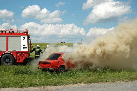 fire extinguishing: JESOV, CZECH REPUBLIC, JUNE 29, 2008 - Exercise firemen, demonstration of fire extinguishing of car
