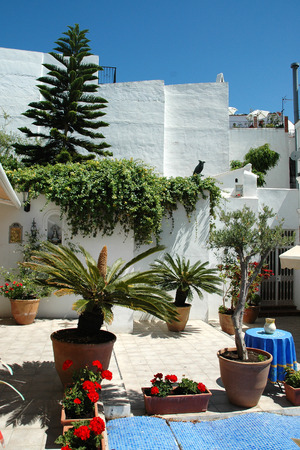 cosy: Cosy courtyard between the white houses in Spanish Andalusia Editorial