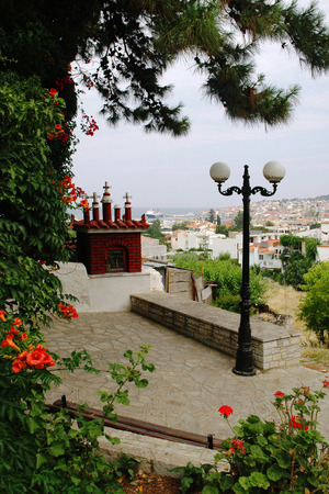 nook: The nook with small chapel and lamp over town of Samos, Greece Stock Photo