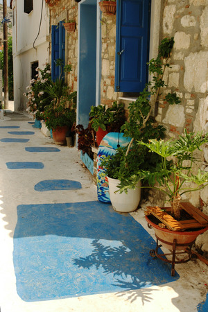 nook: Nook with flowers on street on the Greek island of Samos