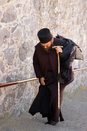 PATMOS, GREECE, JUNE 13, 2005 - The monk returning to the monastery on the island of Patmos