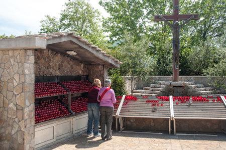 reverent: MEDJUGORJE BOSNIA AND HERZEGOVINA MAY 12 2010 Pilgrims at Reverent place next to the church of Saint James Medjugorje Editorial