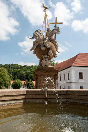 enduring: Stone fountain behind the sculpture of the Holy Trinity in Enduring Freedom, Czech Republic