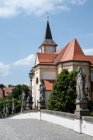 enduring: View of the old Baroque bridge and St. John the Baptist church in Enduring Freedom, Czech Republic