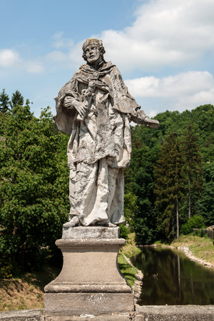 enduring: Baroque statue of St. John of Nepomuk on a bridge in Enduring Freedom, Czech Republic Stock Photo