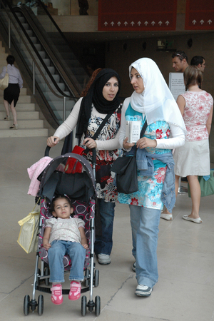 muslim baby: PARIS, FRANCE - AUGUST 18, 2006: Unidentified two Muslim women with a baby on a stroller Editorial