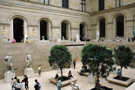 museum visit: PARIS, FRANCE - AUGUST 18, 2006: Tourists visit sculpture gallery in Museum Editorial