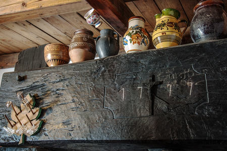 winepress: Painted mugs with decoration on an old press in the wine cellar Stock Photo
