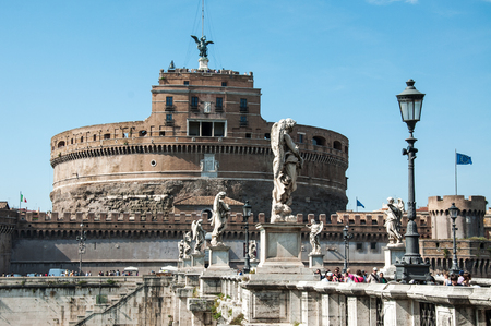 tiber: ROME, ITALY - MAY 12, 2012: The Mausoleum of Hadrian Usually known as the Castel SantAngelo, is a towering cylindrical building in Parco Adriano Rome Editorial