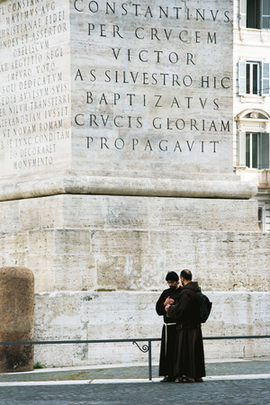 constantine: ROME, ITALY, MAY 09, 2012: Two monks under Constantine Obelisk - the largest to the monolith in the world