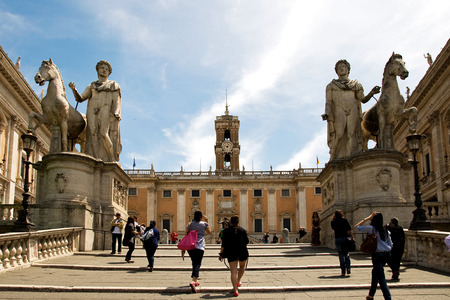 neoclassic: ROME, ITALY, MAY 09, 2012: Tourists rise to the Capitoline Square surrounded by neo-classic buildings with museums clock tower Editorial