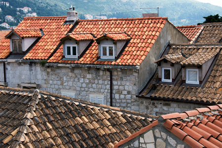 View from Old City Walls in Dubrovnik, Croatia on tiled roofs with windows