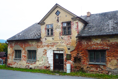Old, very dilapidated village house, insensibly repaired