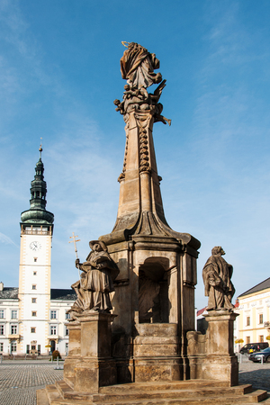 LITOVEL, CZECH REPUBLIC - NOVEMBER 4, 2017 - Plague Column in the square Town Hall tower in the background