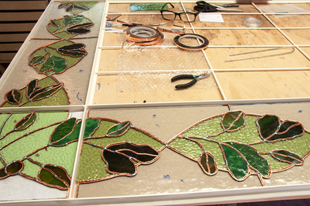Still life at the window glazing manufacturer working on window stained glass Фото со стока
