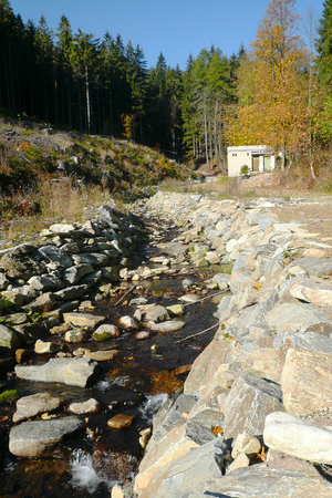 Mountain stream in Jeseniky Mountains, Czech Republic, where this autumn has very little water Фото со стока