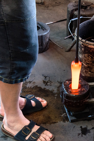 Artistic glassmaker creates a replica of the historical cup in his workshop in the Moravian Region of the Czech Republic