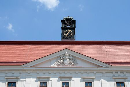 HOLESOV, CZECH REPUBLIC, JUNE 16, 2018 - Facade of Holesov Chateau, Moravia, with coat of arms and clock