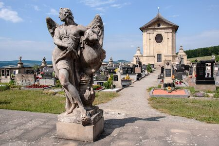 STRILKY, CZECH REPUBLIC, JUNE 16, 2018 -Statues at unique baroque cemetery in the village of Strilky, Moravia Редакционное