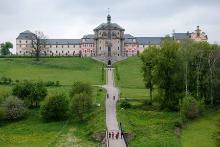 KUKS, CZECH REPUBLIC - MAY 16, 2019: People walking in front of historic hospital Kuks which was renovated in 2013-2015