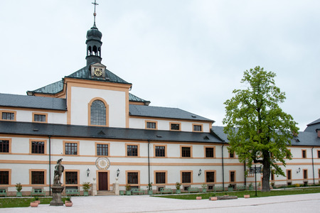 Courtyard of the historic hospital with Holy Trinity Church in the village of Kuks renovated in 2013-2015, Czech Republic