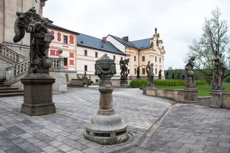 KUKS, CZECH REPUBLIC - MAY 16, 2019: The facade of the historic Kuks hospital with a number of statues by the famous sculptor Matthias Braun from 1712-1731. The hospital building was renovated in 2013-2015 Редакционное