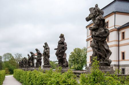 KUKS, CZECH REPUBLIC - MAY 16, 2019: A series of statues by Matthias Braun, a prominent sculptor in a hospital building in the village of Kuks. They were created in 1712-1731