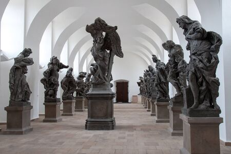 KUKS, CZECH REPUBLIC - MAY 16, 2019: Hall of stone collection with statues that depict vices and virtues in the historical hospital Kuks, Czech Republic. The sculptor Matthias Braun created the sculptures in 1712-1731 Редакционное