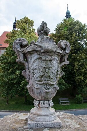 STRILKY, CZECH REPUBLIC, JUNE 16, 2018 - One of the four large stone vases on the walls of the unique baroque cemetery in the village of Strilky, Moravia