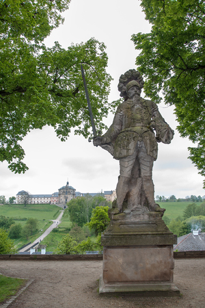 KUKS, CZECH REPUBLIC - MAY 16, 2019: Statue of Goliath by Matthias Braun from 1720, in background newly renovated Kuks hospital