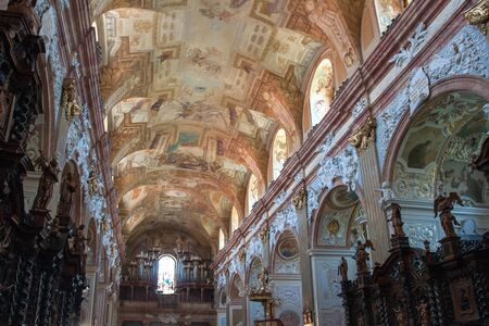 VELEHRAD, CZECH REPUBLIC - JUN 01, 2019: Interior of the Basilica of Assumption of Virgin Mary Cyril and Methodius with rich decoration and painted ceiling