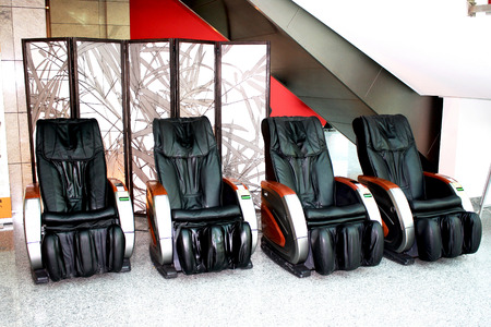 four electric massager chairs for customers
