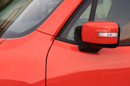 replaced: replaced car mirror colored the same as vehicles