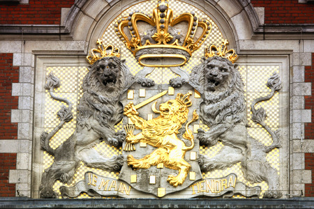 amasing: Amasing detail of the Amsterdam Central Train Station, The coat of arms of the Netherlands.