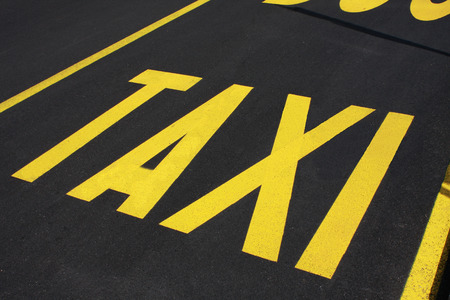 taxi: Taxi stop sign on the road