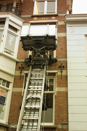 canal house: Canal house facade with a lifting machine in Holland.