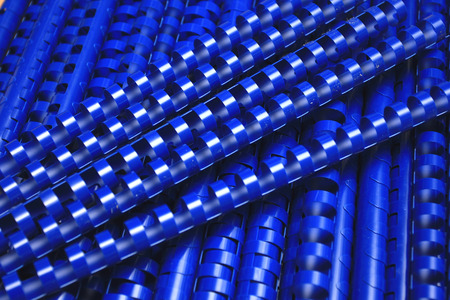 combs: blue plastic binding combs