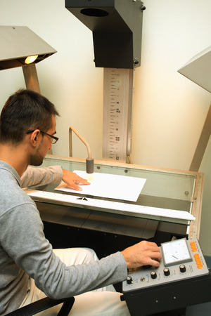 mfp: Man using scanner multifunction device in office