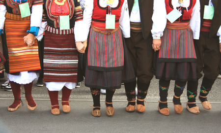 folklore: folklore group from Serbia dressed in traditional clothing is preforming Serbian national dances. Stock Photo