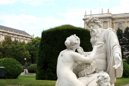 nymphs: Maria-Theresia Platz is home of one of four the beautiful Fountains featuring Nymphs and Tritons. Stock Photo