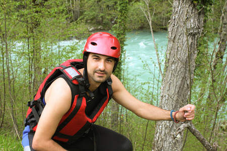lifejacket: Adult man Wearing Water sport and rafting equipment
