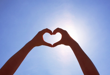 Girls heart hands on the sky Stock Photo