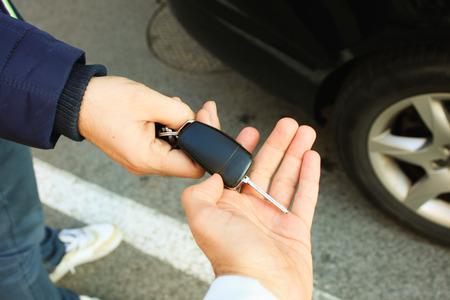 車の鍵をとってバイヤー 写真素材
